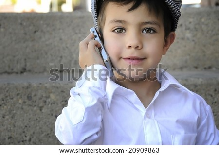 a young child talking on his cell phone