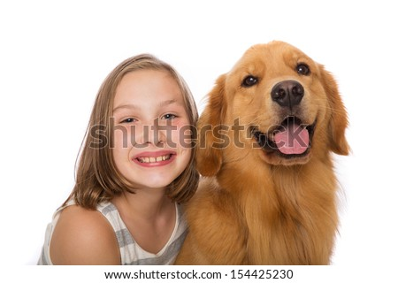 A young child with her golden retriever dog