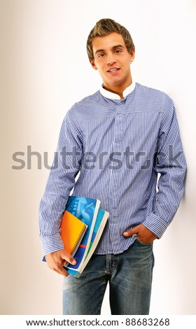A young college guy with books