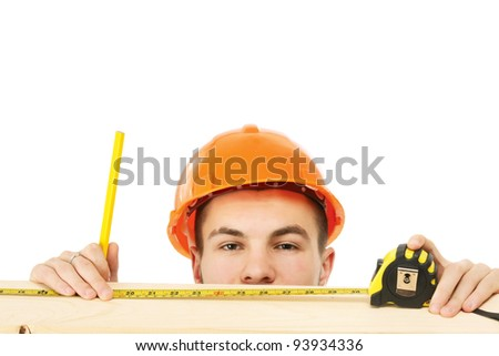 A young construction worker measuring , isolated on white background