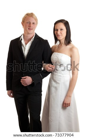 a young couple dressed up posing isolated on white