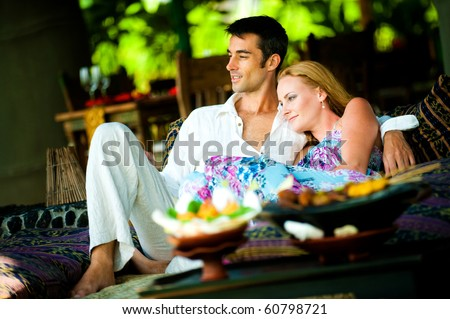 A young couple enjoying a relaxed lunch at a restaurant