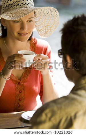 A young couple enjoying a romantic cup of coffee with each other