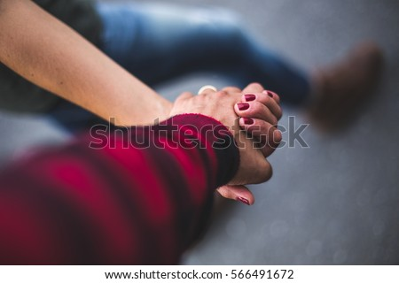 A young couple hand by hand