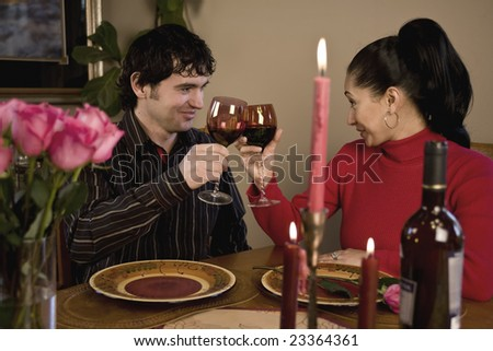 A young couple having a romantic candle light dinner