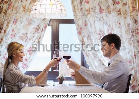 A young couple having romantic  dinner at a restaurant