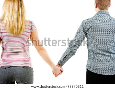 A young couple holding each other's hands. View from the back