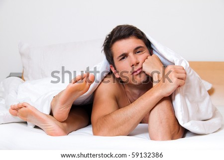 A young couple in bed having problems and crisis. Divorce and separation.