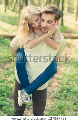 a young couple in love having fun in the spring forest