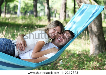 a young couple in love on a hammock