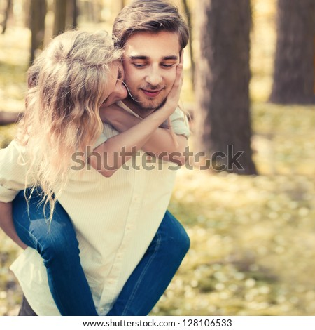 a young couple in love walking in the woods