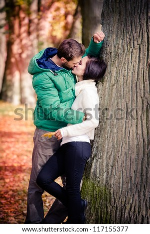 a young couple in the autumn park