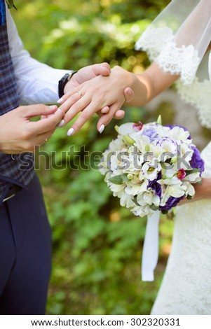 a young couple puts ring #302320331