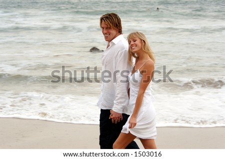 couple holding hands in rain. 2 people holding hands at