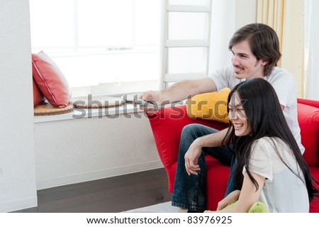 a young couple watching TV
