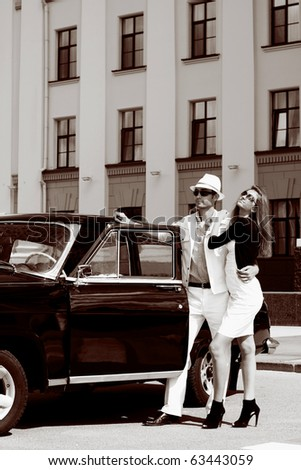 A young couple with a retro car