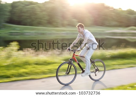 A young cyclist riding a bike