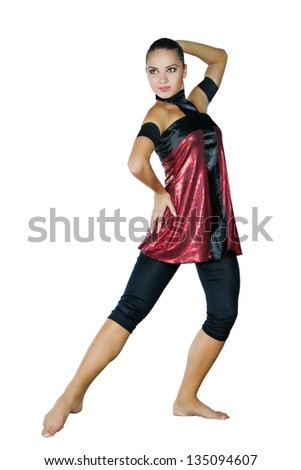 a young dancer  dances in a red dress - stock photo