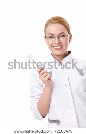 A young dentist with a tool on a white background