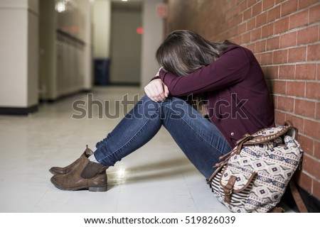 A Young depress female student at the college