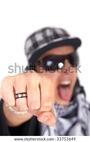 A young DJ is pointing at the camera and screaming. The focus is on his fist! Isolated over white.