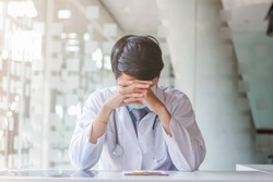 A young doctor was sitting at the window in the morning after taking care of the patients with coronavirus covid-19 who was unable to find a way to stop the coronavirus covid-19 outbreak.