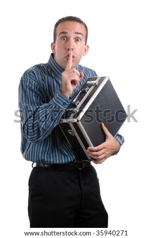 A young employee is sneaking away a case of private documents and telling the viewer to be quiet, isolated against a white background