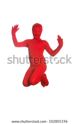 A young, faceless girl wearing a colorful, bright red body suit jumping in the air.