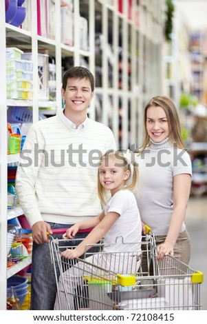 A young family is shopping in a store