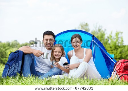 A young family with a tent on the nature - stock photo