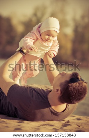 A young father with a baby