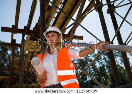 A young female constructor at building of a new motorway in Germany