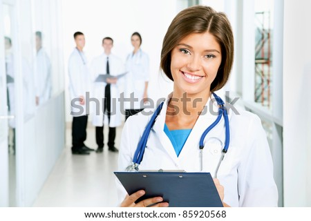 A young female doctor looking at camera