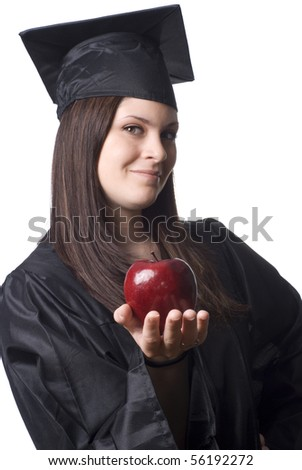 A young female graduate holding a red apple. - stock photo