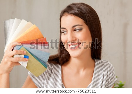 A young female looking at a group of color swatches