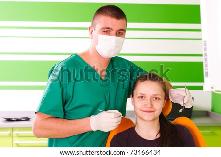A young female patient at the dentist smiling,  being happy for the dental treatment.