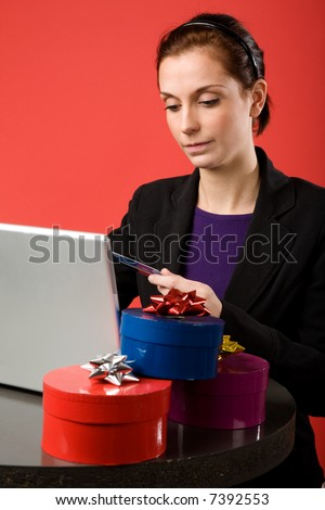 A young female shopping for christmas presents online.
