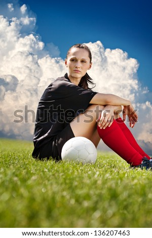 a young female soccer player on the field