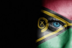 A young female with the flag of Vanuatu painted on her face on her way to a sporting event to show her support.