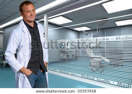 A young friendly doctor in a modern clinic - stock photo