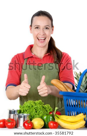 a young friendly grocery store assistant with thumbs up stock    a young friendly grocery store assistant   thumbs up