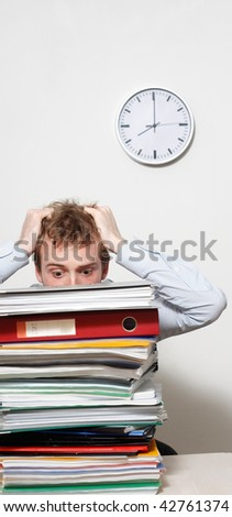 A young frustrated business man - stock photo