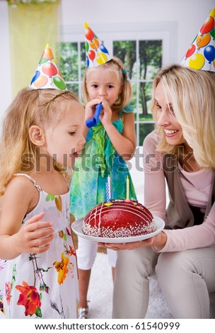 a young girl celebrating birthday at home