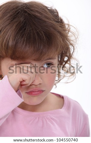 A young girl crying - stock photo