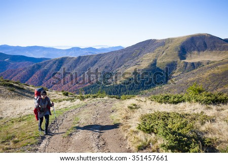 A young girl deals with Hiking in the mountains. #351457661