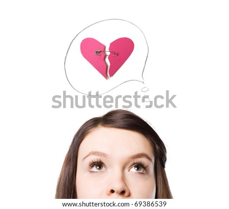 A young girl dreams of love. A symbol of Valentine. - stock photo
