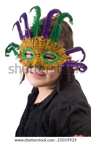 A young girl getting her portrait done while wearing a feather mask, isolated against a white background