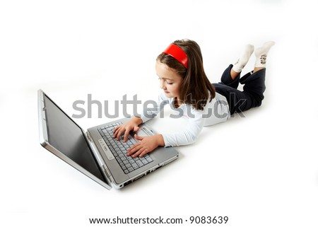 A young girl handling a laptop isolated on white