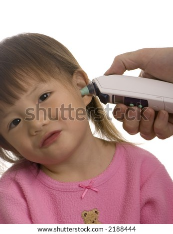 A young girl has her temperature taken