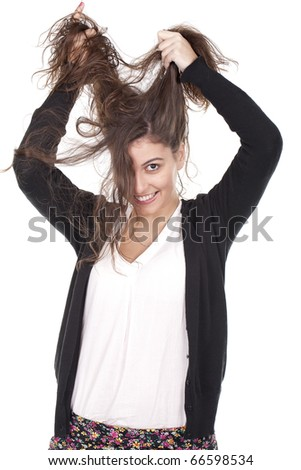 a young girl having fun and pulling her long hair